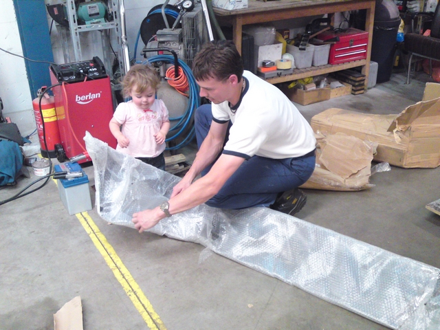 Unpacking rear bumper with daughter