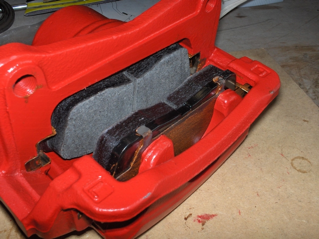 Brake caliper with brake pads installed