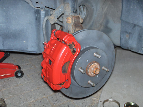 Red Corolla brake calipers