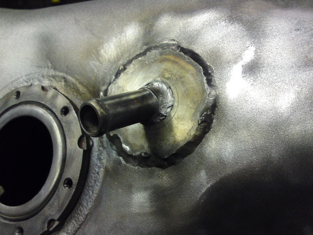 Piece welded to fuel tank